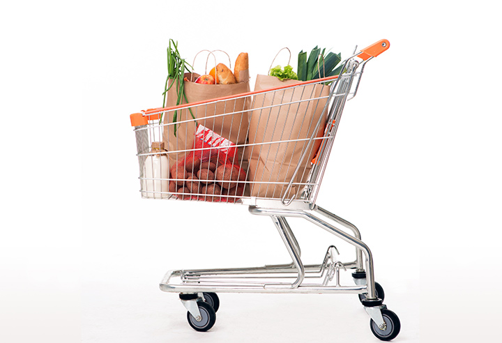 Cart with brown shopping bags