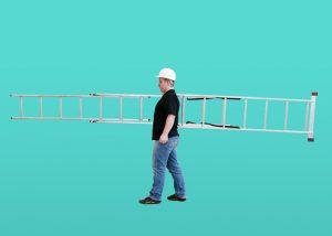 Man carrying an extension ladder
